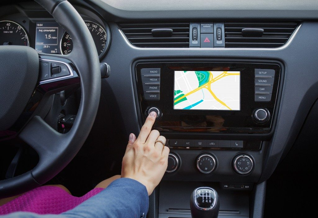 """""""Woman using a navigation system while driving a car"""