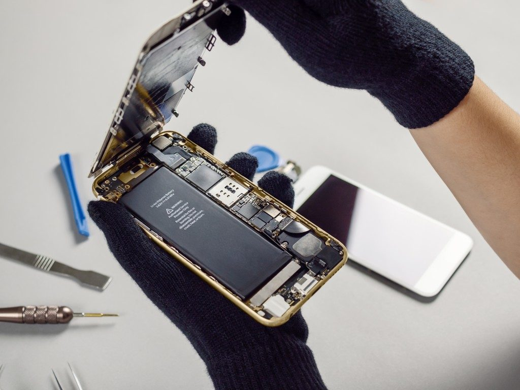 broken down smartphone showing internals