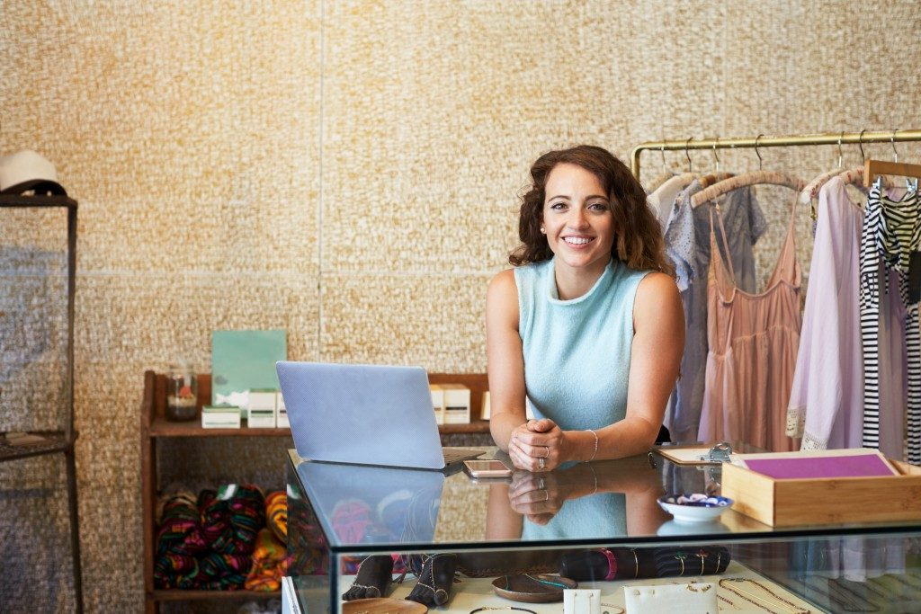 Small business owner manning her shop