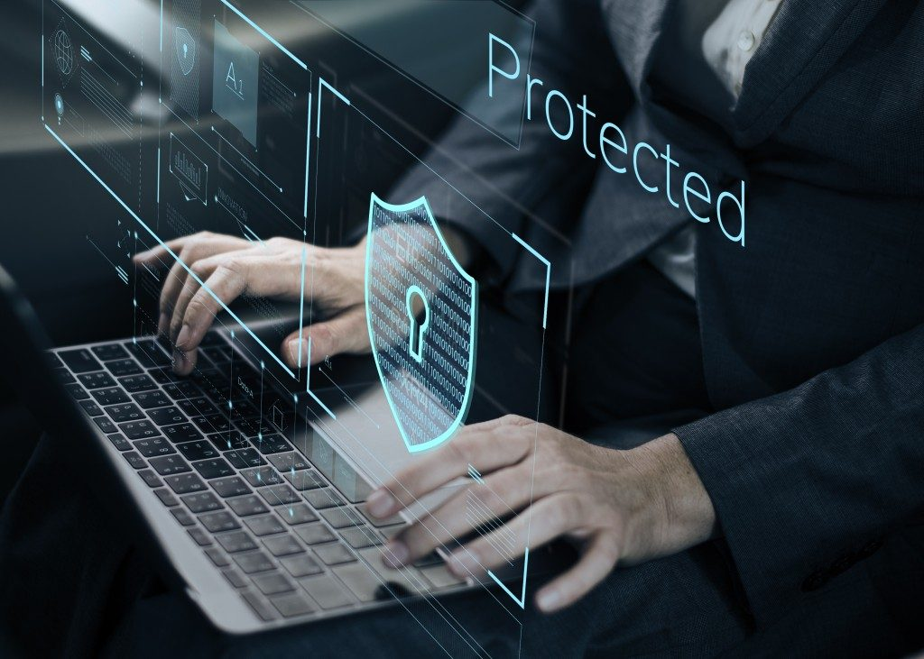 Digital Protection concept with lock symbol projecting on laptop