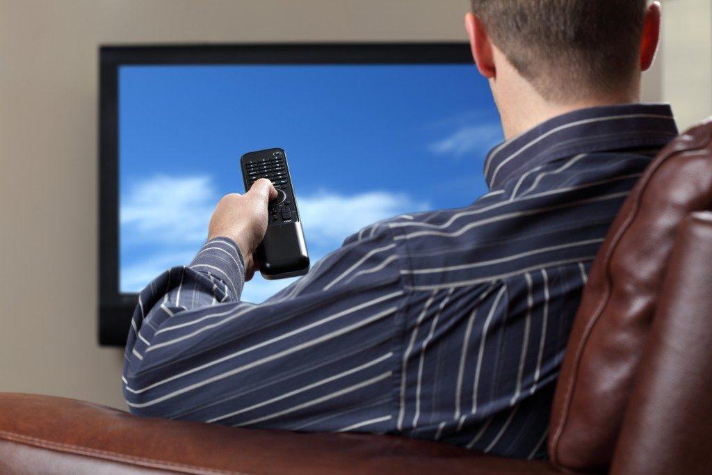 man watching tv on the sofa
