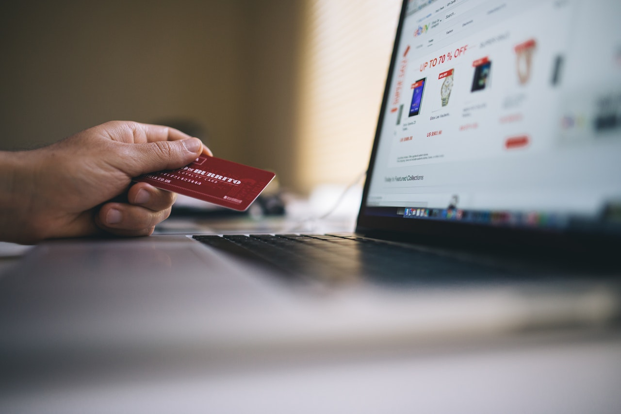 holding credit card while shopping online
