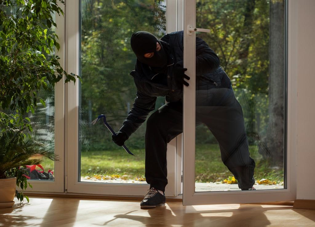 burglar entering a home